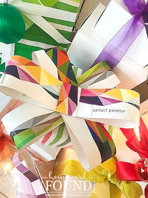 art,art class,paper crafts,Christmas,Christmas Decor Themes,holiday,color,colorful home,color palettes,DIY,diy decorating,gift wrapping,re-purposing,colorful gift wrapping,paint chips,paint chip crafts,upcycled paint chips,rainbow color palette,Christmas gift wrapping,gift wrap inspiration, bows.