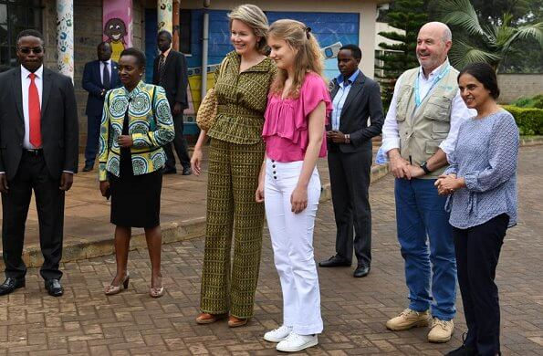 Queen Mathilde Dries Van Noten jacket and trousers, Natan dress, Crown Princess Elizabeth in Maje blouse and white trousers