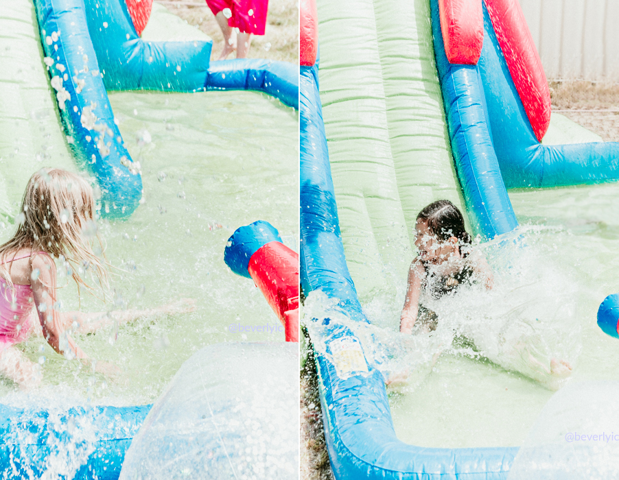 kids having fun with water slide from target australia in a birthday party