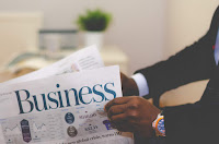 Man reading a business newspaper  Image: unsplash.com