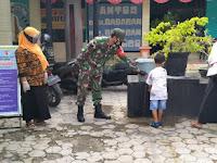 Dalam Suasana Pandemi, Babinsa Koramil 0802/03 Babadan Himbau Warga di Posyandu Untuk Patuhi Protokol Kesehatan