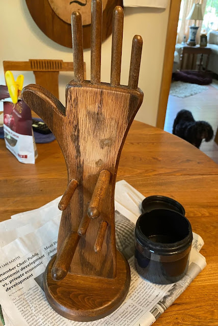 Photo of a dark wooden hand shaped jewelry holder