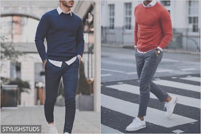 Two mens are walink on the road wearing a crew neck sweater.
