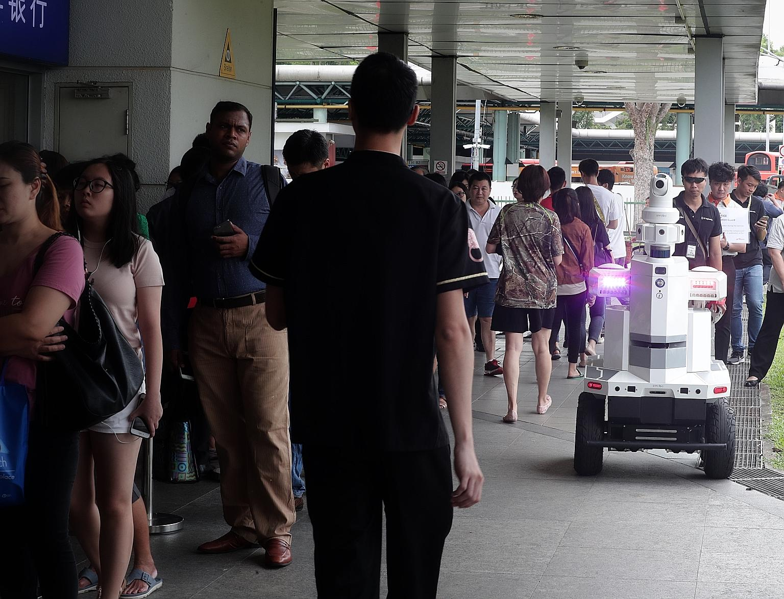 An autonomous robot kept an eye on Hougang MRT station yesterday as part of Exercise Station Guard, an emergency preparedness exercise by the Land Transport Authority (LTA).