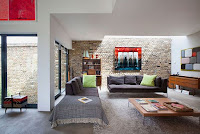 Mediterranean interior with brick wall accent