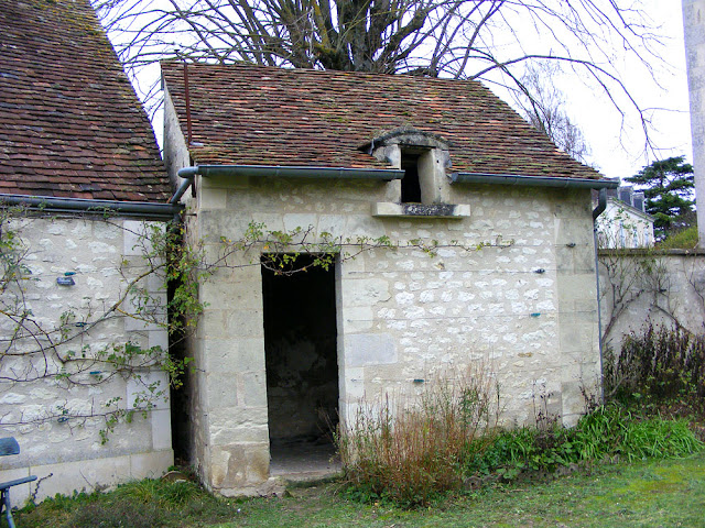 Hen house in a garden (formerly a dovecote).  Indre et Loire, France. Photographed by Susan Walter. Tour the Loire Valley with a classic car and a private guide.