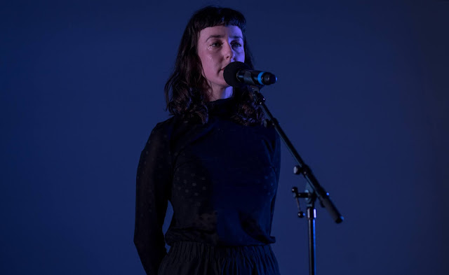 Photo if a woman performing on stage at the Just start here festival by National theatre 2020 - Photo by Jordanne lee creative