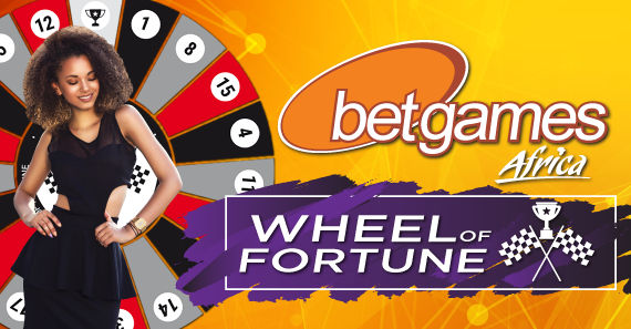 Betgames Africa model poses in front of wheel of fortune