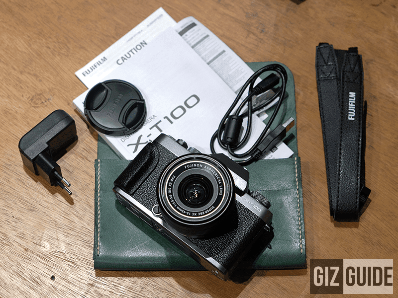 Power plug, lens cap, manual, USB Type-A to micro USB cord, camera body and kit lens