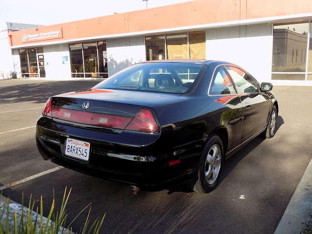 Honda Accord Coupe with peeling paint after repainting at Almost Everything Auto Body.