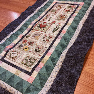 How to wash a quilt with cross stitch embroidery on linen