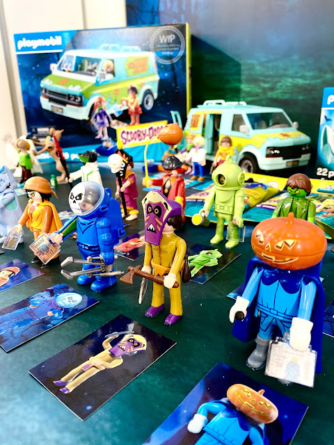 An army of spooky looking Scooby Doo Playmobil characters with the mystery vehicle visible at the back