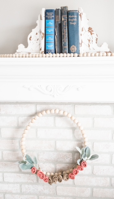 white fireplace mantel French onlay wood beads wreath