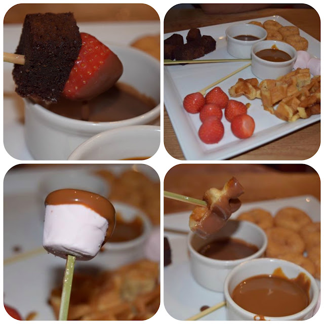 Sharing chocolate fondue dessert at brewers fayre
