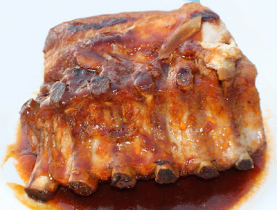 this is a homemade sauce for pork made from scratch with whiskey these are ribs. Homemade barbecue sauce with Jack Daniels Whiskey