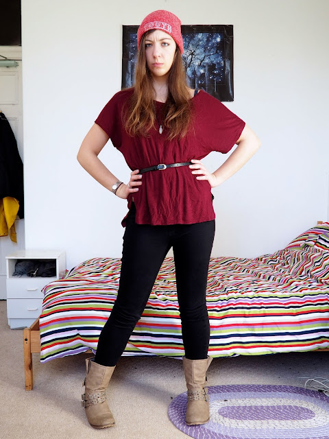 Heigh Ho - Grumpy inspired Disneybound outfit of red tunic top, black skinny jeans, chunky brown boots, and red beanie hat