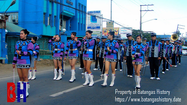 A marching band during a Lipa City fiesta parade.  Property of Batangas History.
