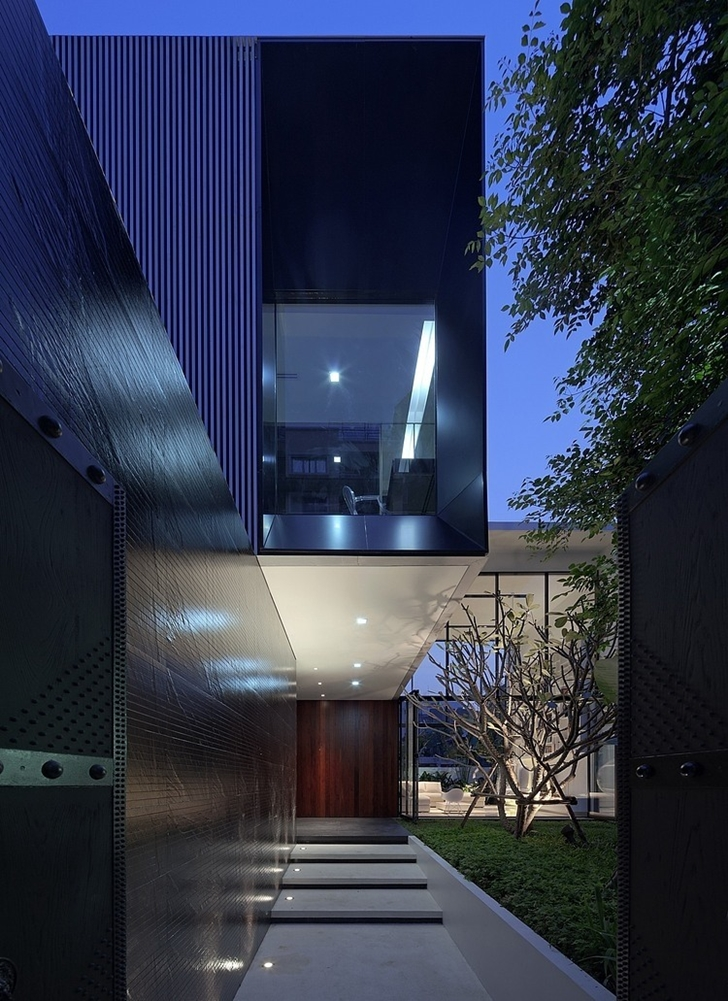 Entrance and facade of Modern mansion in Singapore