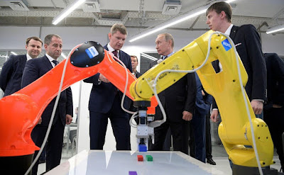 Vladimir Putin watching IT exhibition, organized by ER-Telecom Holding in Perm.