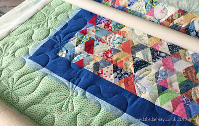 Sue with her 'Twisted Triads' Quilt, quilted by Frances Meredith