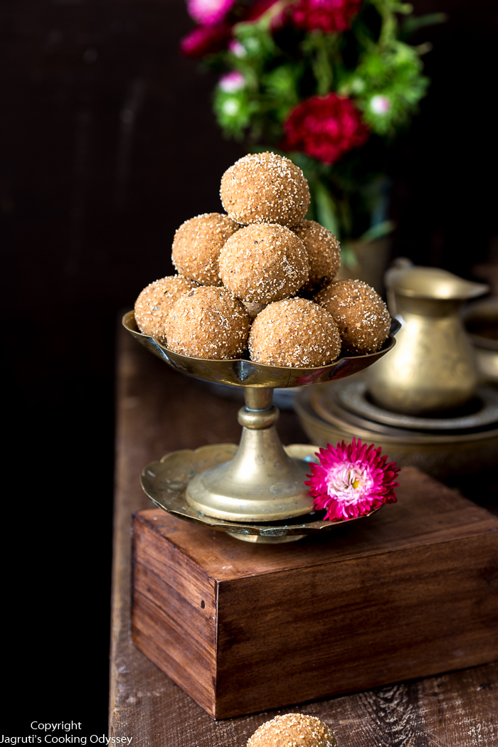 This light brown Gujarati churma ladoo are served in a brass plate,