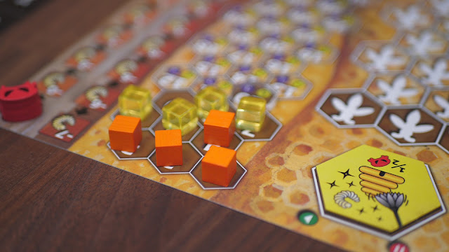 beehive tokens and cubes on the Bee Lives sheets