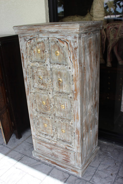 https://www.mogulinterior.com/indian-antique-hand-carved-wooden-whitewashed-cabinet.html