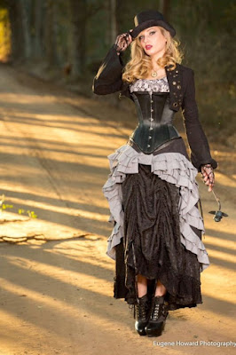 An example of longline corsets used in women's steampunk fashion. this woman is wearing her longline corset with a bustled skirt, top, bolero jacket and hat.