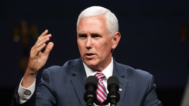 Dozens of students and faculty graduates at  Taylor University walk out to protest Vice President Mike Pence address