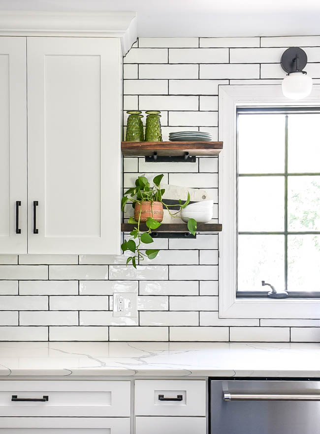 Open shelves in bright white kitchen