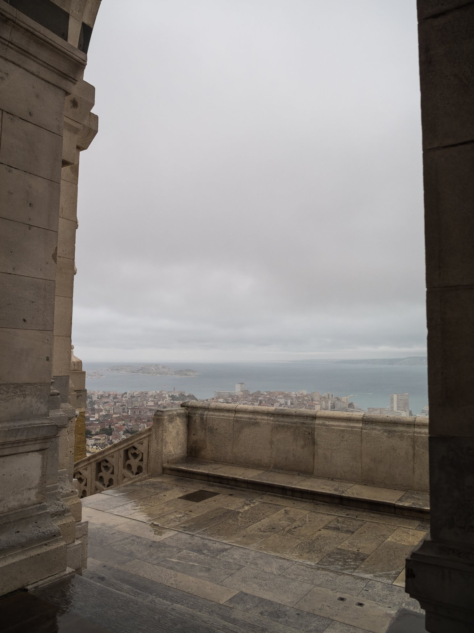 Sheltering rom the rain at the Basilica of Notre Dame de la Garde overlooking Marseille.