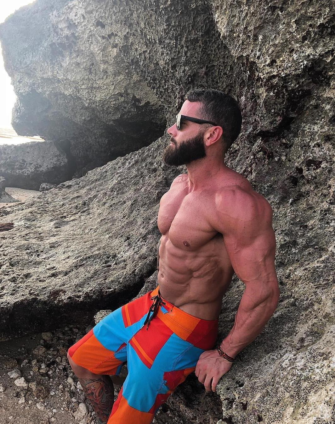sexy-shirtless-fit-dark-bearded-daddy-parker-egerton-black-sunglasses-big-swole-pecs-strong-arms-dilf