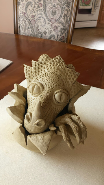 Dragon Hatchling pottery sculpture by Lily L, in progress.