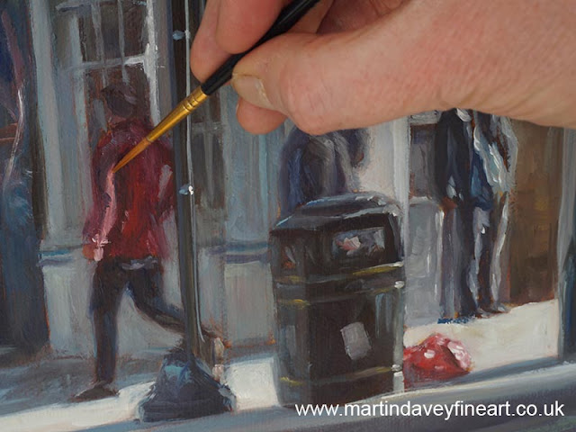 figure in street painting underway with brush