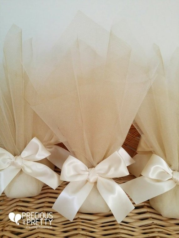 Ivory and gold wedding favors with tulles