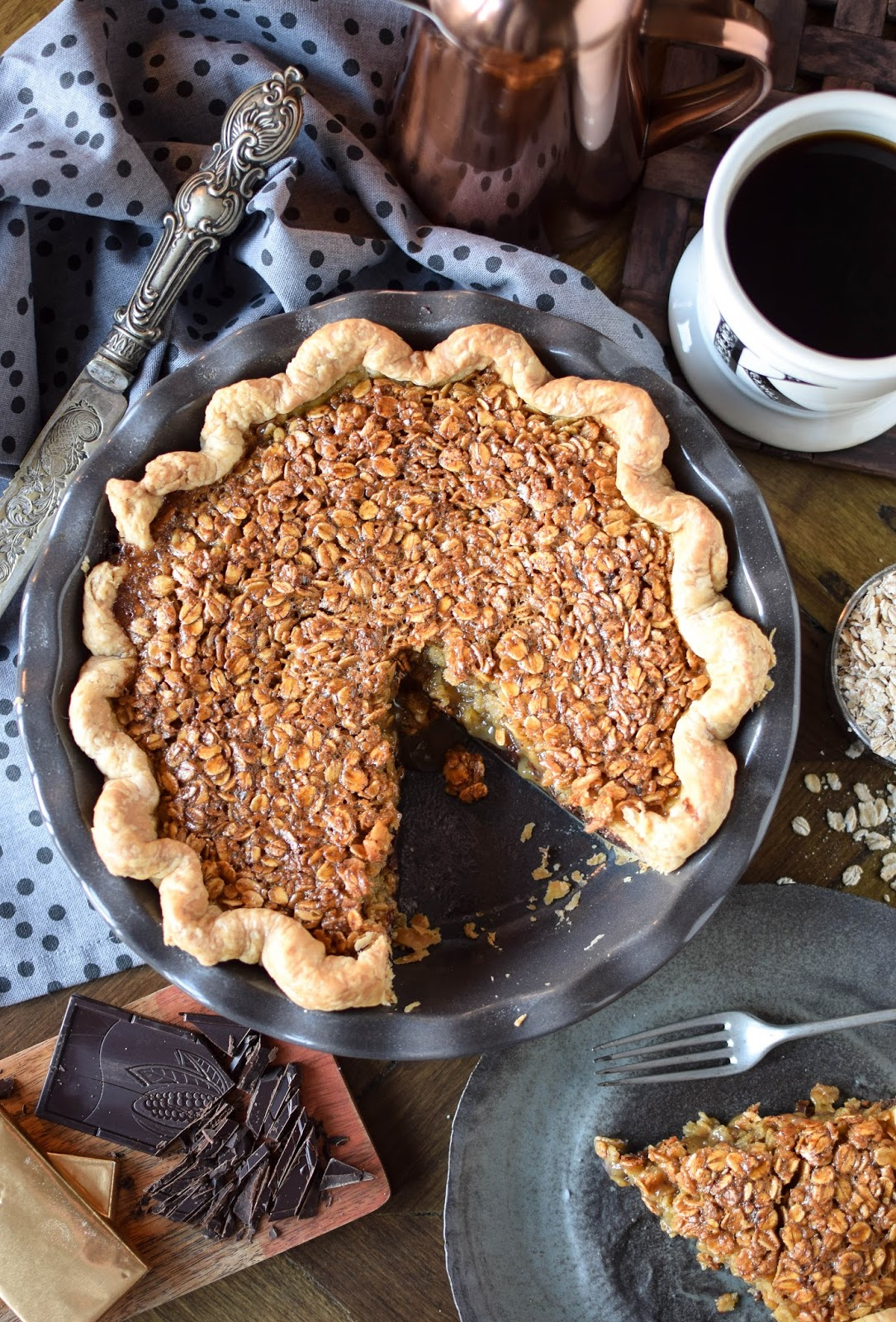 Often referred to as poor mans pecan pie this black bottomed oatmeal pie is a bit easier on the pockets that it's nutty sibling.  A layer of chocolate ganache topped with a syrupy oatmeal filling sitting in a buttery crust makes this a truly rich and decadent dessert. There's nothing poor about this pie.
