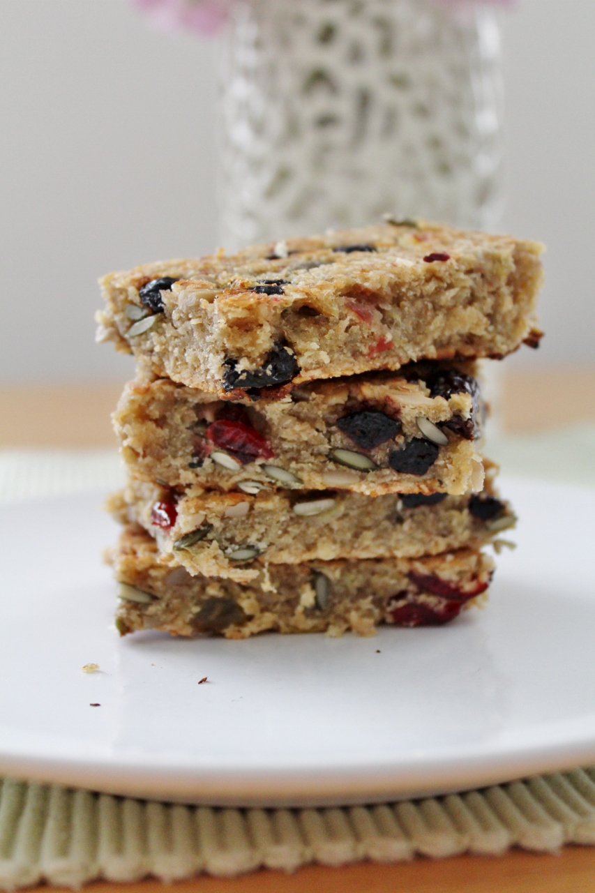 Stack of homemade banana flapjacks with seeds and fruits