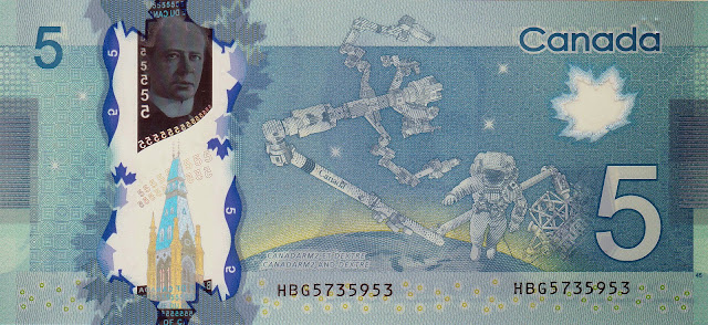 Canada money currency 5 Canadian Dollar Polymer Note 2013 Astronaut working on the International Space Station