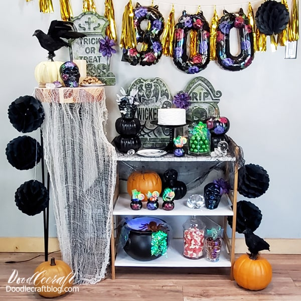 Put the whole mystic flowery party together! Add a cake, cookies, candy and maybe your favorite Halloween themed foods. I love having a decorated serving area because it shows my guests all my decorations in one place!  If you are setting big tables, add the same decorations to the centerpieces and place settings.