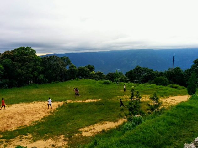 A game of football surrounded by nature's bounty at Latikynsew, Meghalaya