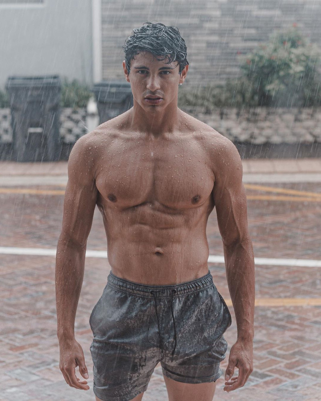 cute-fit-shirtless-wet-guy-raining-outdoor-mysterious-young-hunk