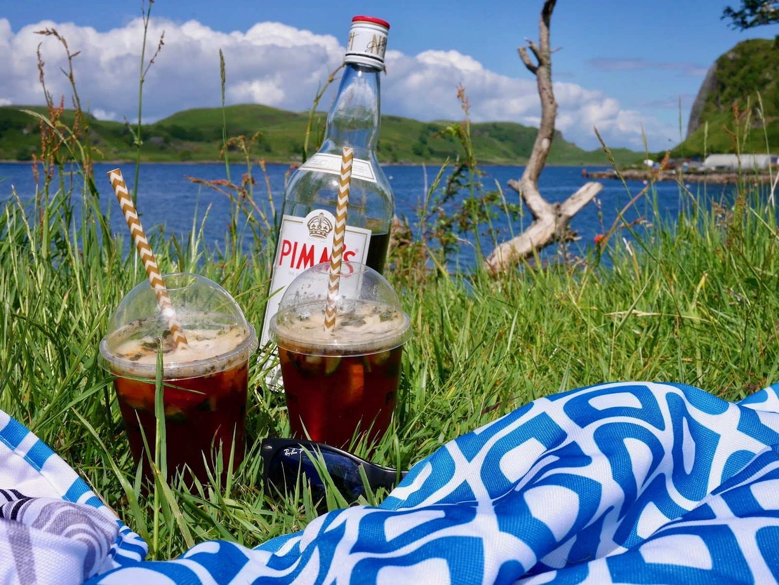 Drinking pimms on the banks of the loch in Oban