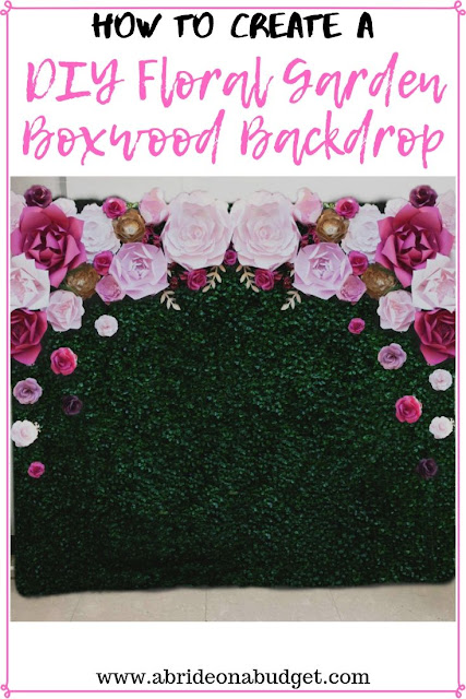 You can have a floral wall at your wedding without spending a ton on it. Find out how to create a DIY floral garden boxwood backdrop on www.abrideonabudget.com.