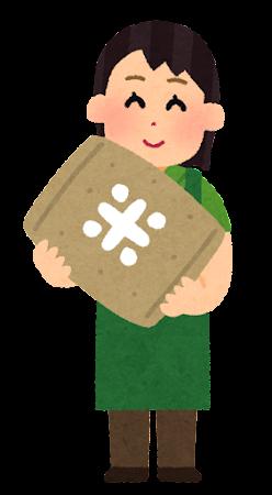 米袋を持つ人のイラスト(店員の女性)