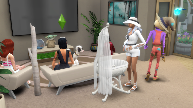 Screen grab of 4 sims as one of the sims is in labor