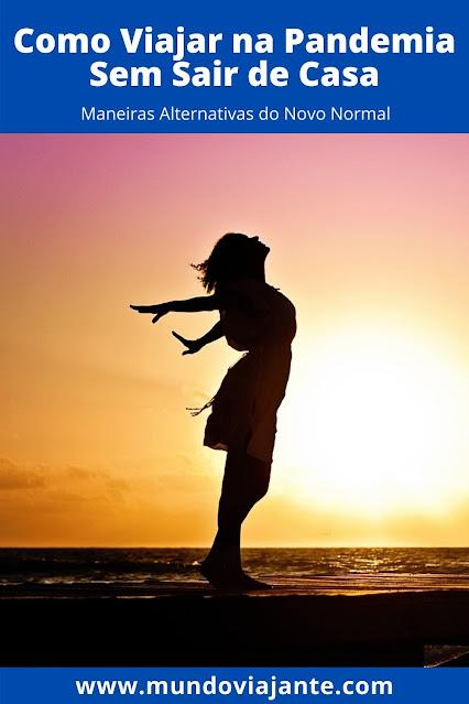 silhueta de mulher no horizonte de braços abertos como uma aguia