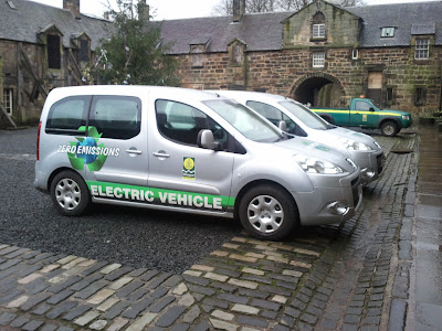 Electric cars in stables at Pollok Park