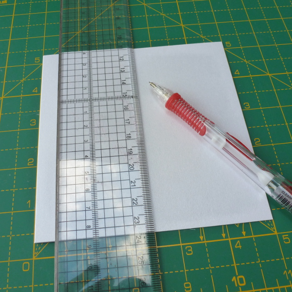 Measuring halfway up the card blank front to make a basic easel card