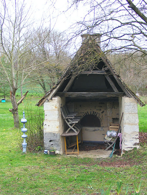 Old bread oven in a garden.  Indre et Loire, France. Photographed by Susan Walter. Tour the Loire Valley with a classic car and a private guide.