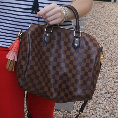 Louis Vuitton Damier Ebene 30 speedy bandouliere with red jeans and striped tank | away from the blue
